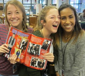 Students showing magazine